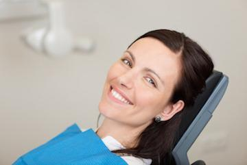 woman smiling in dental chair before appointment in boise
