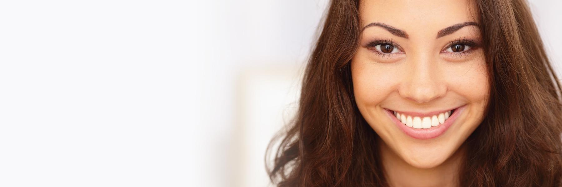 woman smiling after cosmetic dentistry